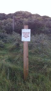high tide sign
